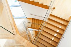 Modern architecture interior with wooden stairs Royalty Free Stock Photo