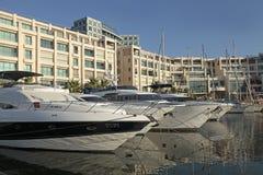 Modern architecture and luxury yacht moored at marina, Herzliya royalty free stock photo