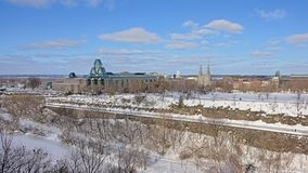 National gallery and Notre Dame cathedral along frozen rideau canal locks , Ottawa on a winter day royalty free stock photography