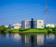 Modern architecture near high tension power lines,. Modern architecture houses, people living near high tension power lines in Almere, the Netherlands stock photography