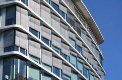 Modern architecture: office building. Brand new modern office building with horizontal aluminium sunblinds Stock Images