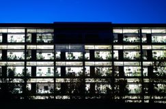 Modern architecture office building illuminated royalty free stock image