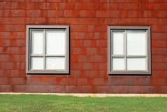 Modern Architecture Rusted Siding. A photograph of a architectural city structure with rusted metal shingled siding and modern silver windows royalty free stock photography