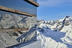 Modern architecture on snowy mountain juxtaposed with nature. Modern architecture on snowy mountain juxtaposed with nature Royalty Free Stock Photography