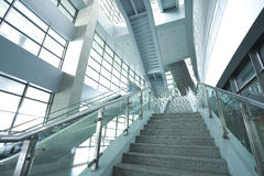 Modern architecture steps of moving business escalator and stair Stock Image