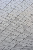 Modern architecture surface cross line. Part of modern construction surface as regular pattern, and sliver gray color, shown as featured background and texture Stock Photography
