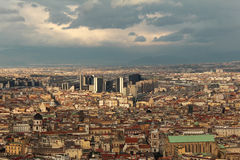 Modern architecture surrounded by traditional buildings. Dramatic sky at sunset over Napoli scenery. Modern buildings in the center of the landscape, surrounded Royalty Free Stock Photo