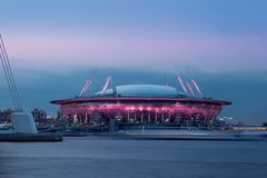 Modern architecture tower on a sunset background. St. Petersburg. Russia. radiance of lights, panorama of the city. Stadium, flyin. G saucer, bay, sea, waves stock image