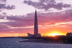 Modern architecture tower on a sunset background. St. Petersburg. Russia. radiance of lights, panorama of the city. Stadium, flyin royalty free stock images