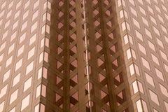 Modern archituctureskyskrapabakgrund Arkivbilder