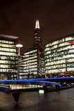 Modern area of London at night. Business area of London with the Shard in background Royalty Free Stock Photography
