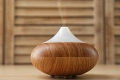 Modern aroma lamp on table stock photo