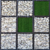 Modern art, block of rock wall and artificial gras Stock Images