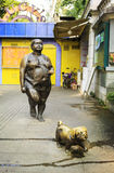 Modern art city sculpture, statue of fat woman and dog walking on sidewalk, street view and urban Scenery in China Stock Photography