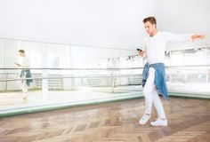 Modern art dancer dressed in white clothes listening a music wit royalty free stock image