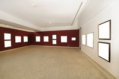 Modern art gallery space with blank canvas Stock Images