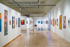 Modern art gallery space with paintings. Modern art white cube gallery space with paitings and with no people Stock Photo