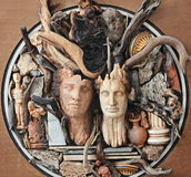 Modern art. In Greece with faces, wood, statues and vases royalty free stock images