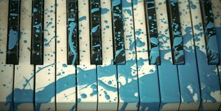 Modern Art. Painted piano, musical style, grunge instrument. Pop and classical music, melody, rhapsody. Art, decoration, design, old piano. Piano in blue paint Royalty Free Stock Image