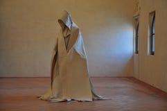 Modern art: sculpture of death. An interpretation of death as a modern art statue. Monk cloak royalty free stock photography