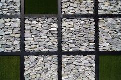 Modern art wall grass and stone Stock Photos