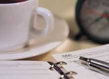 Modern Article. Coffee and Pen royalty free stock photography