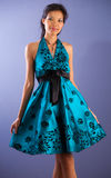 Modern Asian beauty. Modern Asian beauty posed with green satin dress royalty free stock photos