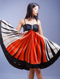 Modern Asian beauty. Modern Asian beauty showing beautiful color of dress stock photo
