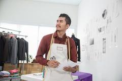 Asian male fashion designer. Modern asian male fashion designer in his workshop Stock Images