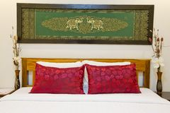 Modern Asian-style bed with nice silk screen with frame in bedro Stock Photo