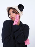 Modern Asian woman with hat and ear muffs Stock Photography