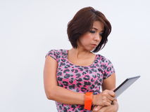 Modern Asian woman holds electronic tablet Stock Images