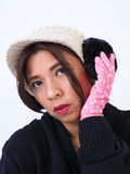 Modern Asian woman portrait with gloves and ear muffs Stock Photography