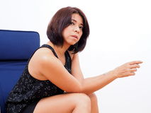 Modern Asian woman sits on a rocking chair Royalty Free Stock Images