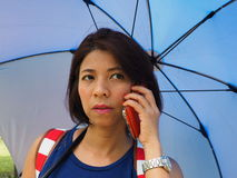 Modern Asian woman using mobile phone outdoor Stock Photography