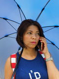 Modern Asian woman using mobile phone outdoor Royalty Free Stock Image