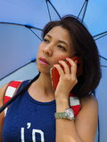 Modern Asian woman using mobile phone Royalty Free Stock Image