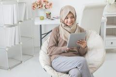 Modern asian woman using tablet pc Stock Photos