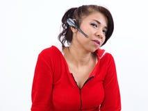 Modern Asian woman using wireless headset Royalty Free Stock Photo
