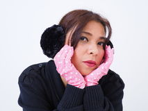 Modern Asian woman wearing pull-over and pink gloves Stock Photo