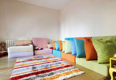 Modern Assorted Colored Rattan Sitting Room. Modern Rattan Sitting Room with Wooden Floors, with colorful rattan seating in an L-shape Stock Photography