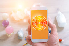 Modern astrology concept with mobile Royalty Free Stock Images