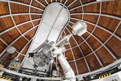 Modern astronomy telescope in an astronomical observatory. Royalty Free Stock Photo