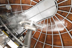 Modern astronomy telescope in an astronomical observatory. Royalty Free Stock Image