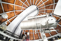 Modern astronomy telescope in an astronomical observatory. Royalty Free Stock Images