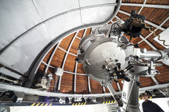 Modern astronomy telescope in an astronomical observatory. Stock Photography