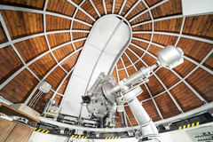 Modern astronomy telescope in an astronomical observatory. Stock Photos