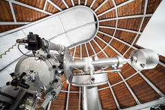 Modern astronomy telescope in an astronomical observatory. Royalty Free Stock Photos