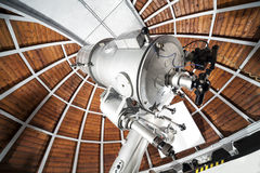 Modern astronomy telescope in an astronomical observatory. Stock Photo