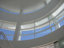 Modern Atrium Architecture at the Getty Center. Modern architecture of the atrium at the Getty Center in Los Angeles. Large windows, white walls, and blue sky Stock Image